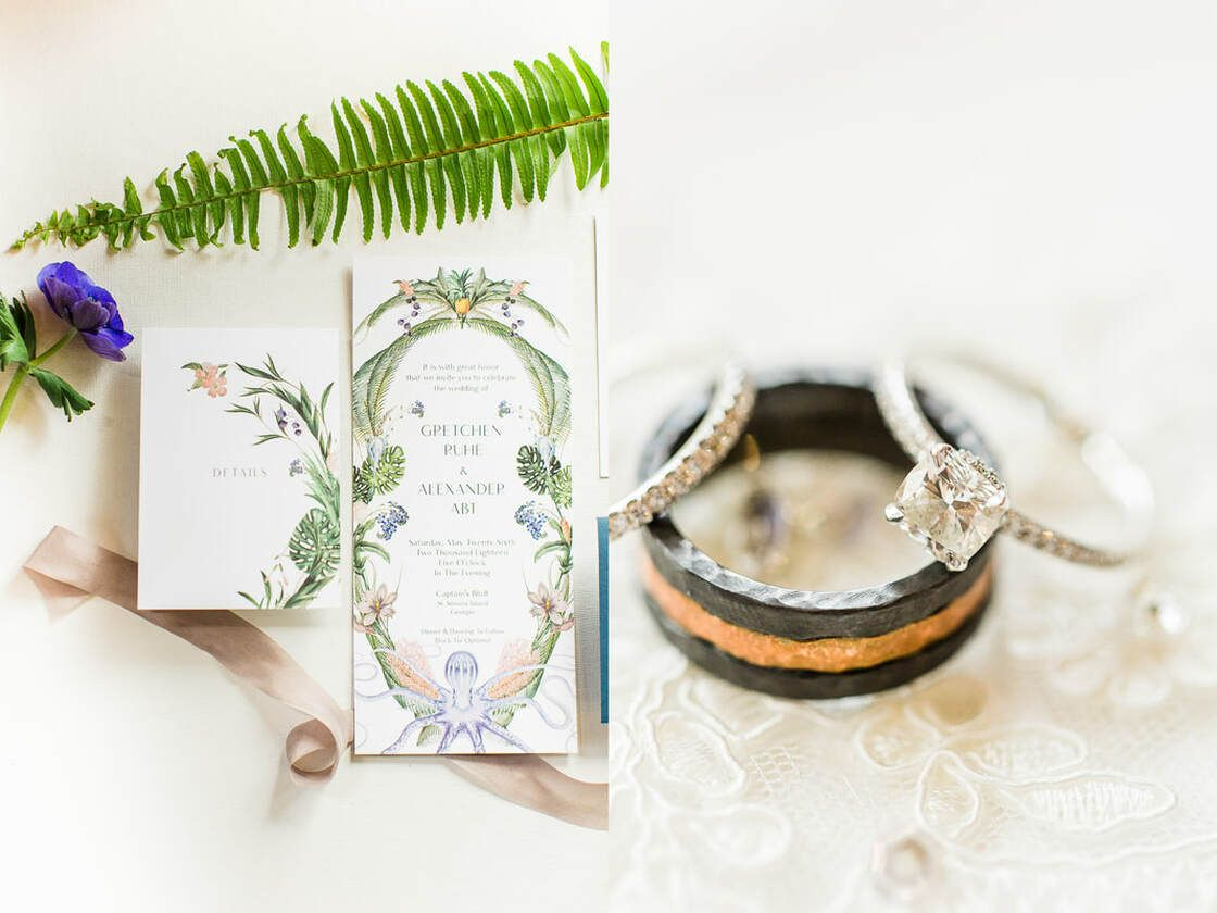 styled wedding invitation and wedding bands at captain's bluff in st simons island, ga