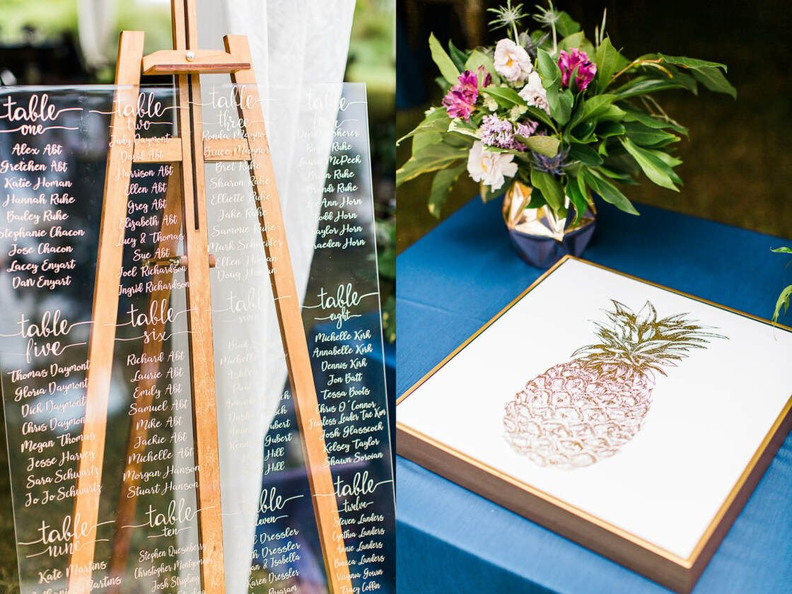 guest seating chart and pineapple guest book at captain's bluff wedding reception