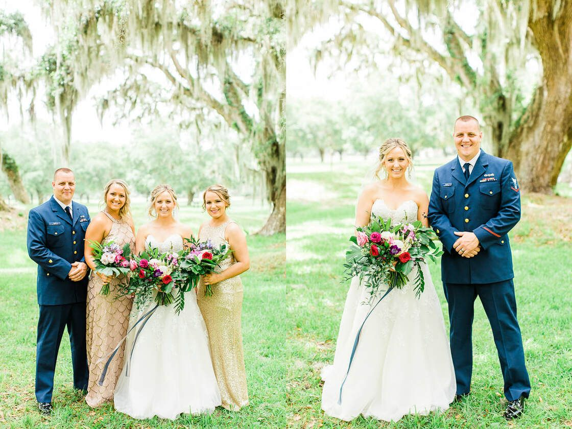 wedding party and family taking portraits under the oak trees at fort frederica on st simons island, ga