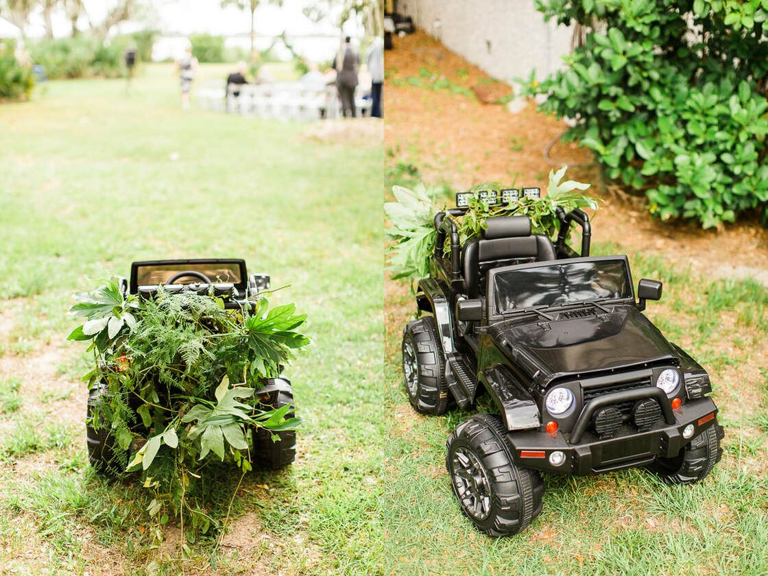 ring bearer's jeep outfitted with greenery for the ceremony