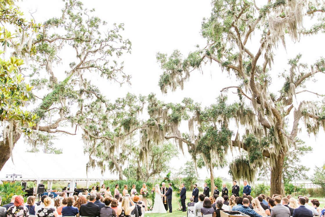 wedding ceremony under the moss covered trees at captain's bluff on st simon's island, ga