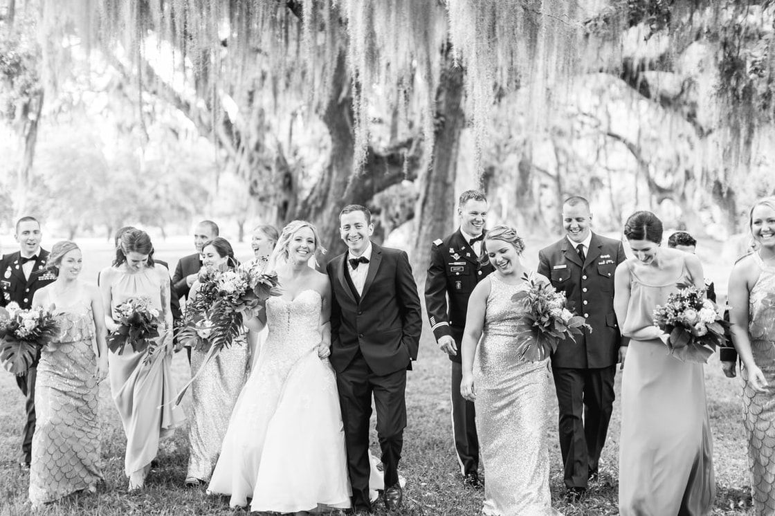 wedding party under the oak trees at fort frederica on st simons island, ga