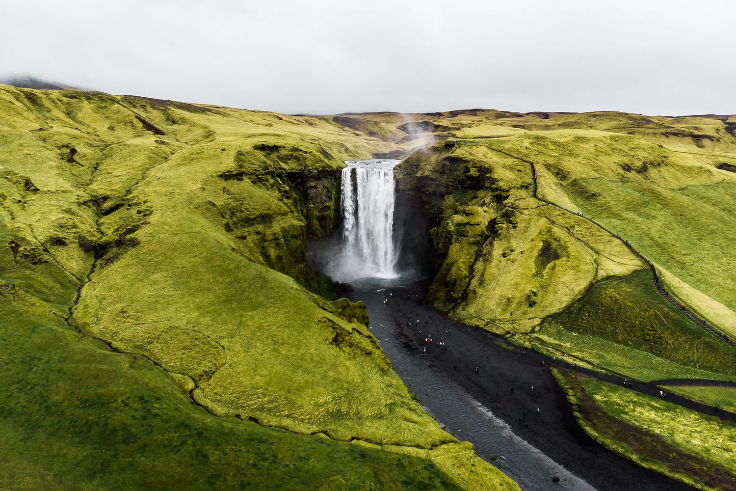 Adventurous elopement location Skógafoss Waterfall Iceland