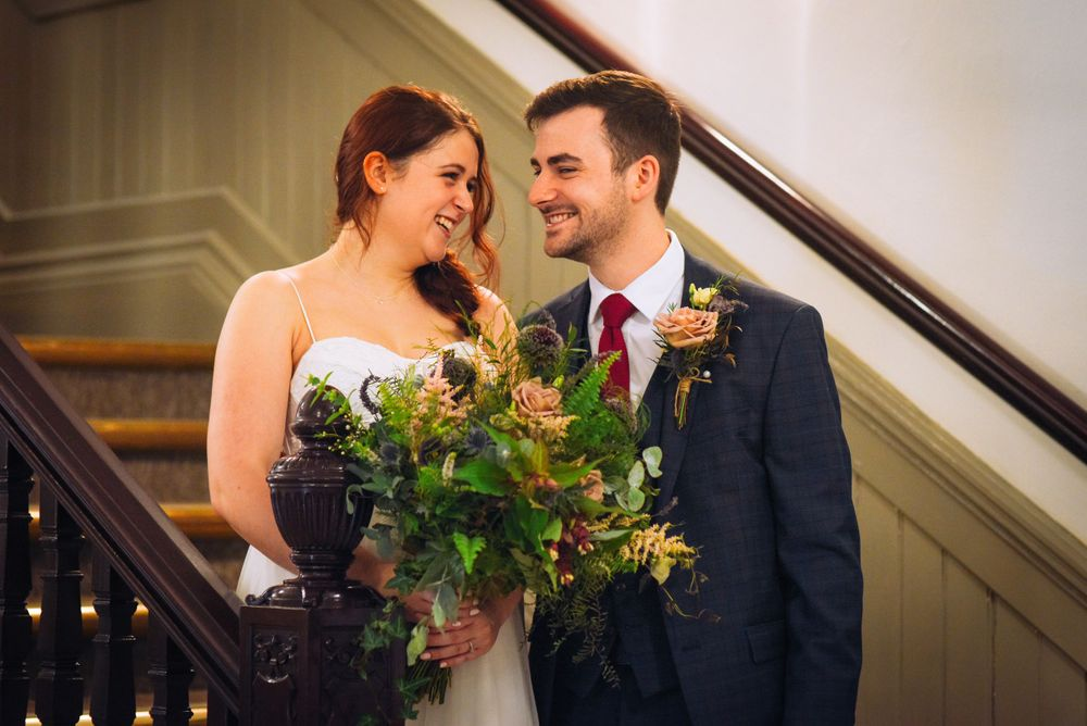 Frome Town Hall wedding by Zara Davis Photography, Gloucestershire staircase bride and groom looking at each other