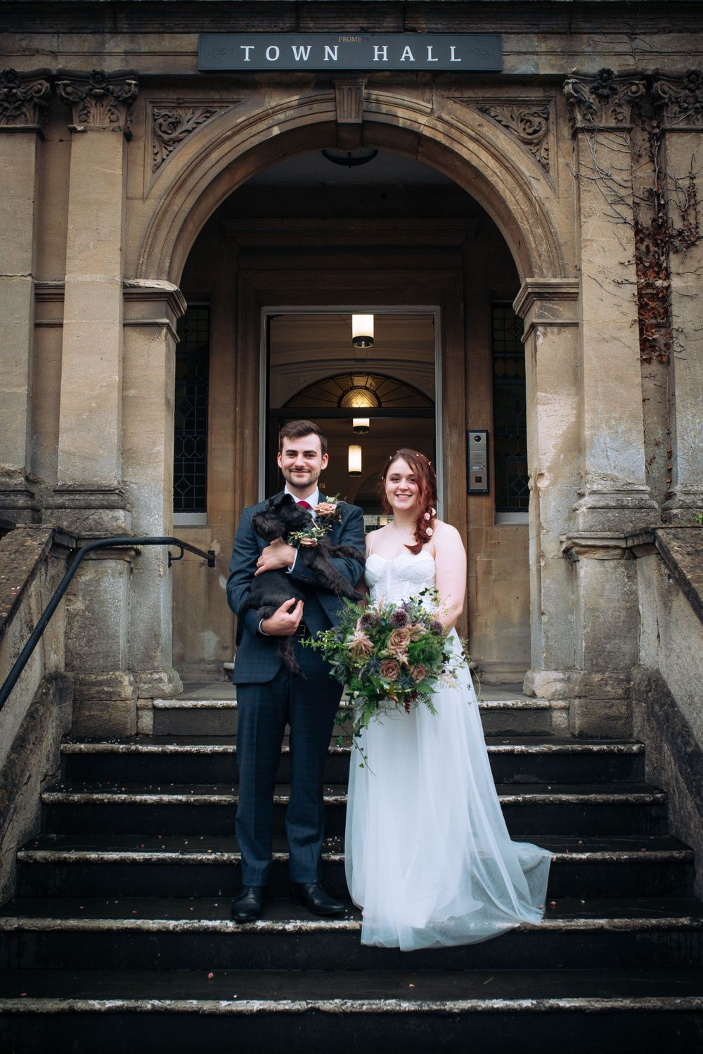 Frome Town Hall wedding by Zara Davis Photography, Gloucestershire just married outside with dog