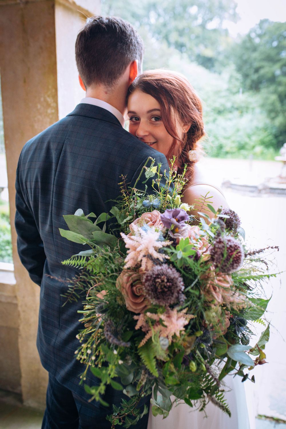 Charlton House Hotel wedding by Zara Davis Photography, Gloucestershire shy bride and bouquet