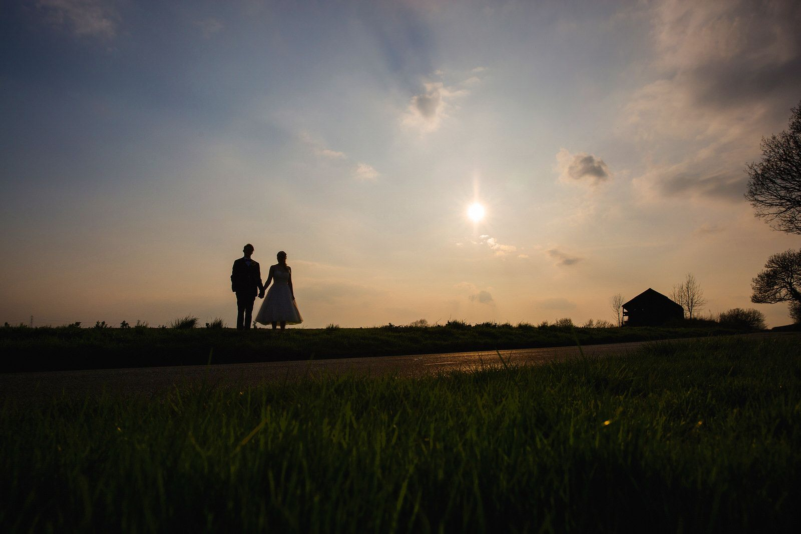 Bride & Groom in silhouette in at Donnington Park Wedding Venue