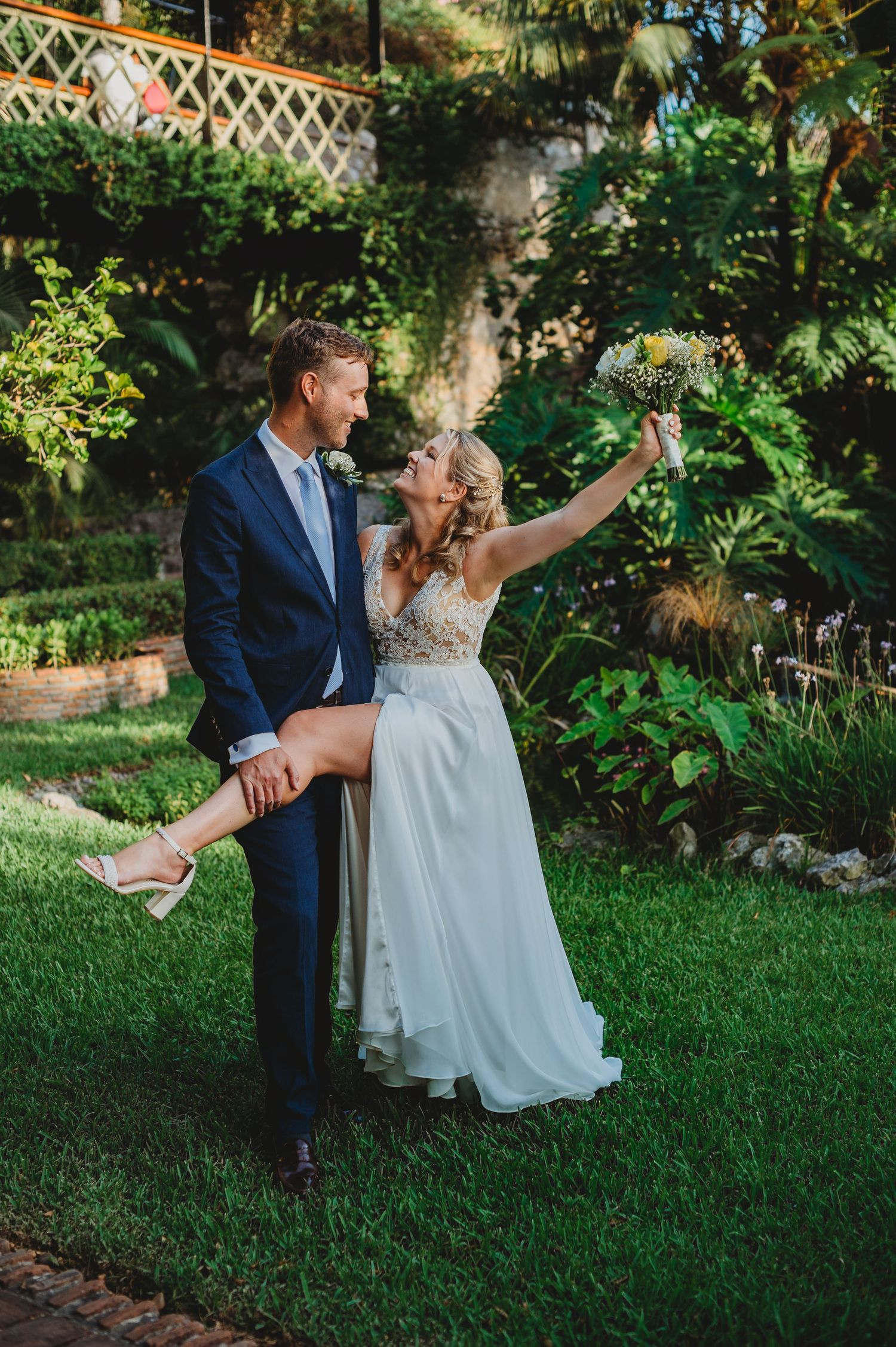 Bride giving leg to hold to groom