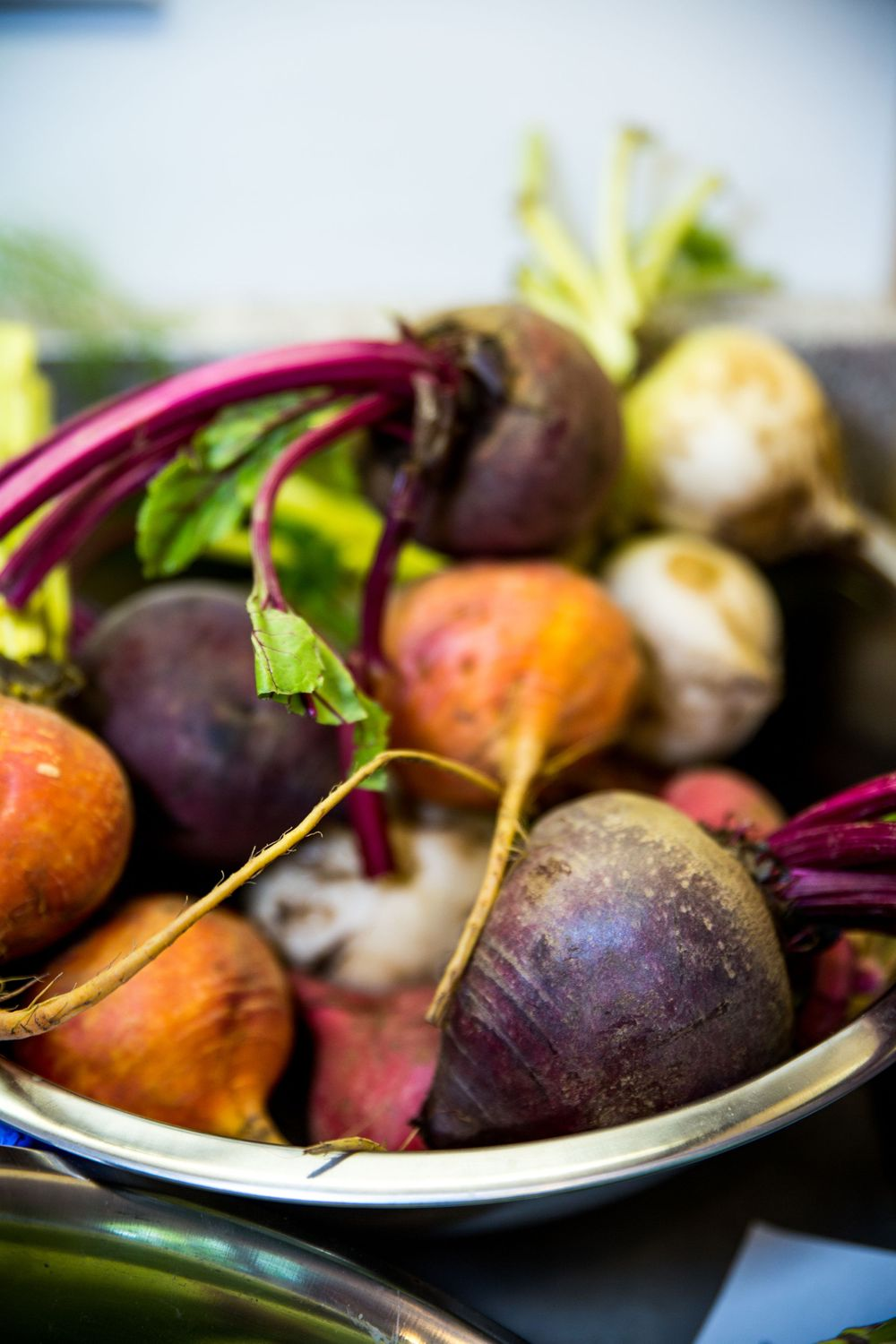 Stainless steel bowl of rainbow beets by Basil, Garlic & Rosemary Cooking Classes based in Annapolis, MD. | DANIE