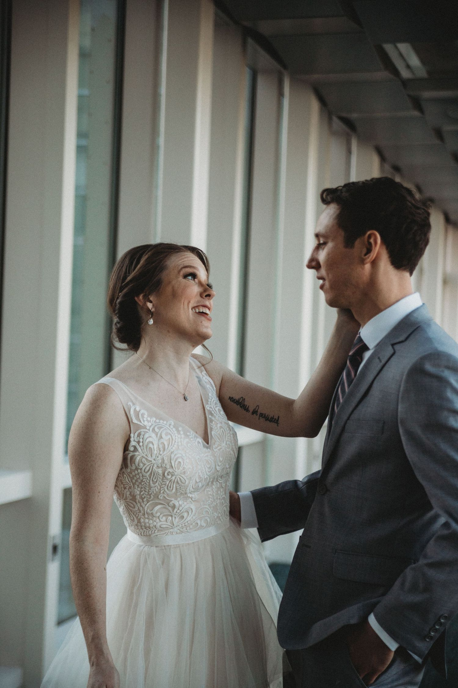 man and wife discuss wedding details on skywalk