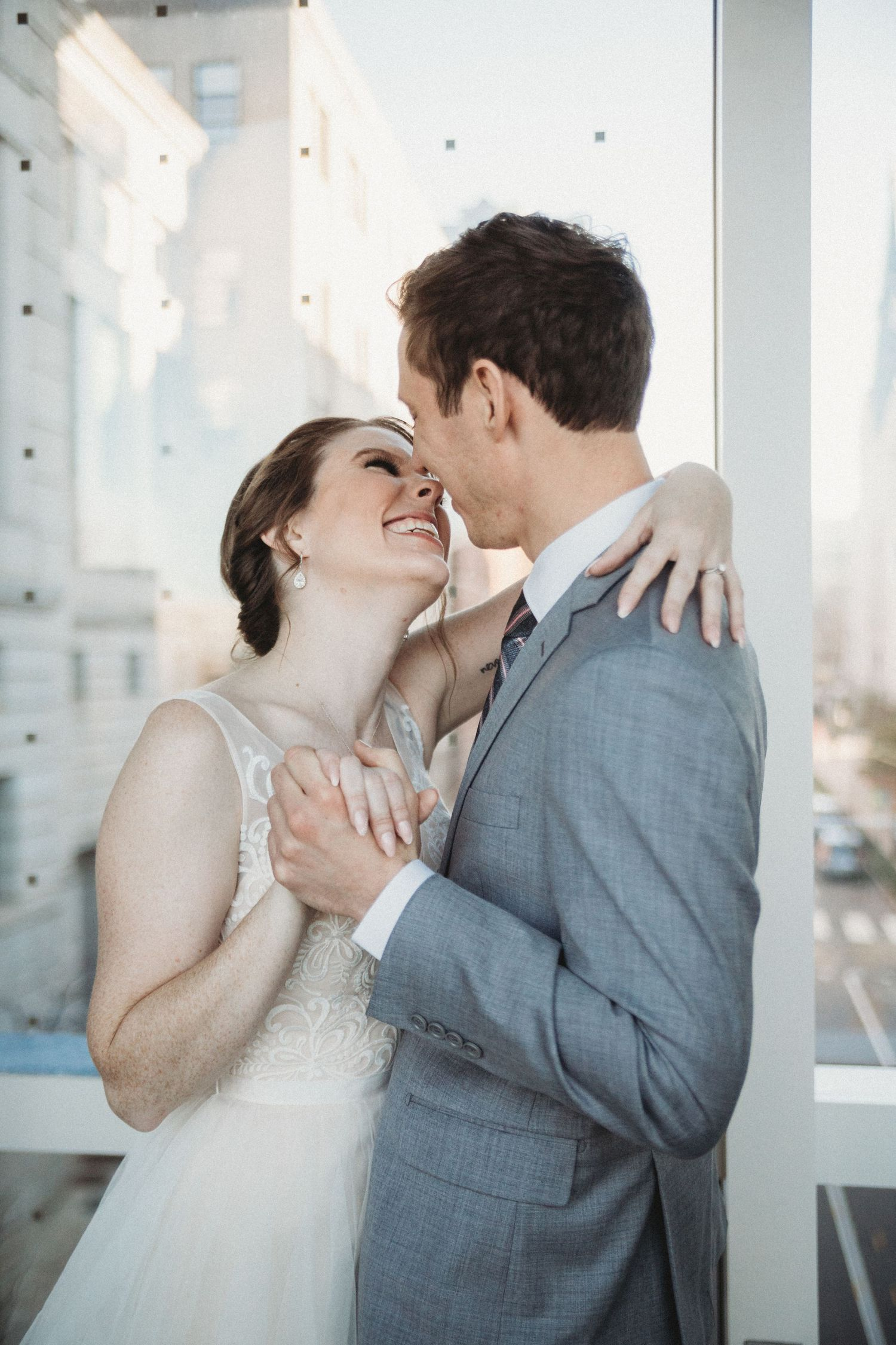 bride and groom almost kiss on sky walk