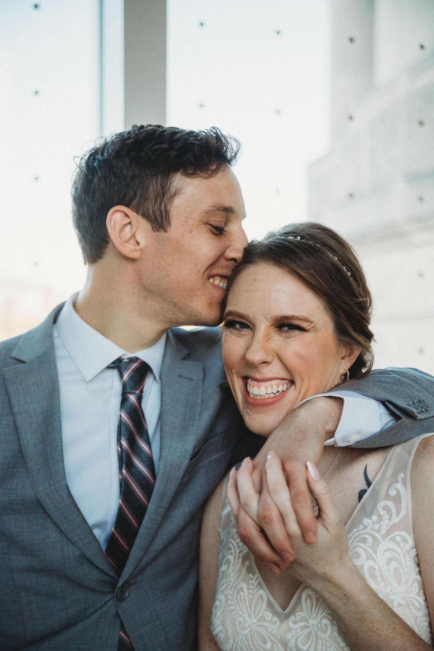 groom whispering sweet nothings into brides ear