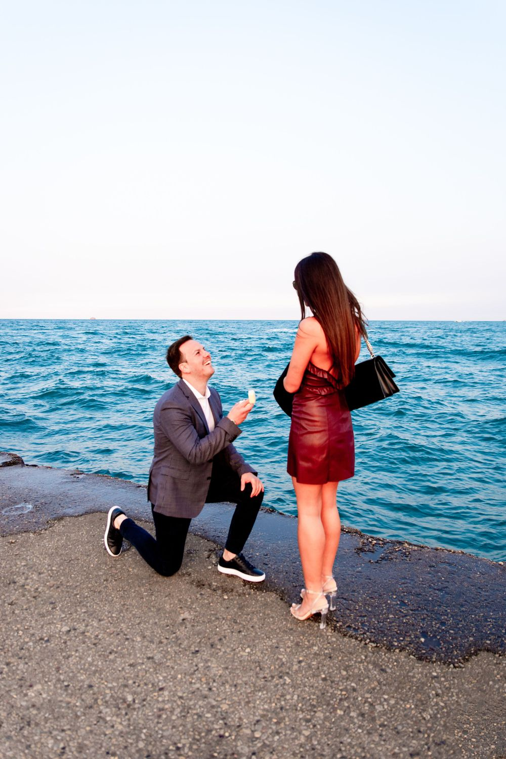 man on one knee proposing in Chicago