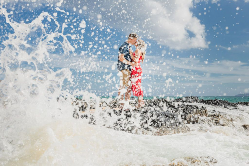 splashing wave on a romantic surprise proposal session
