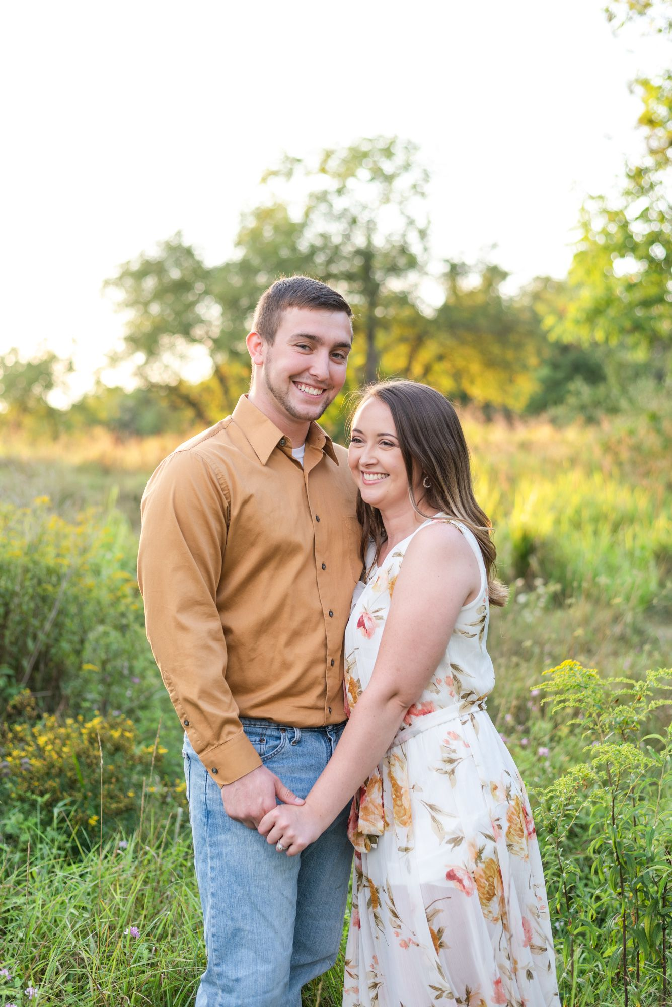 Couple for engagement in tall grass at Moraine State Park in Pennsylvania
