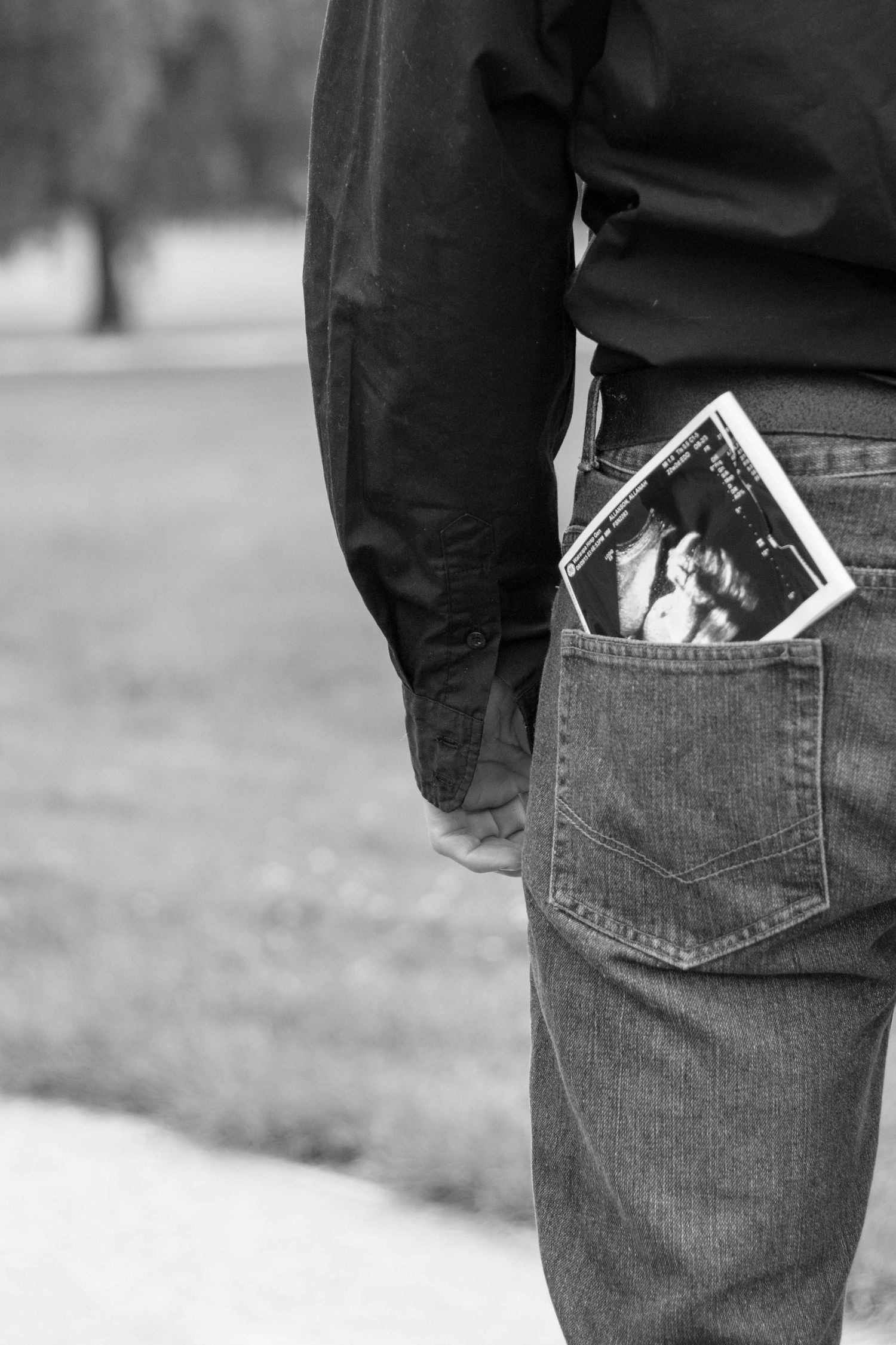 Baby scan in back pocket of father black and white - Masterton NZ