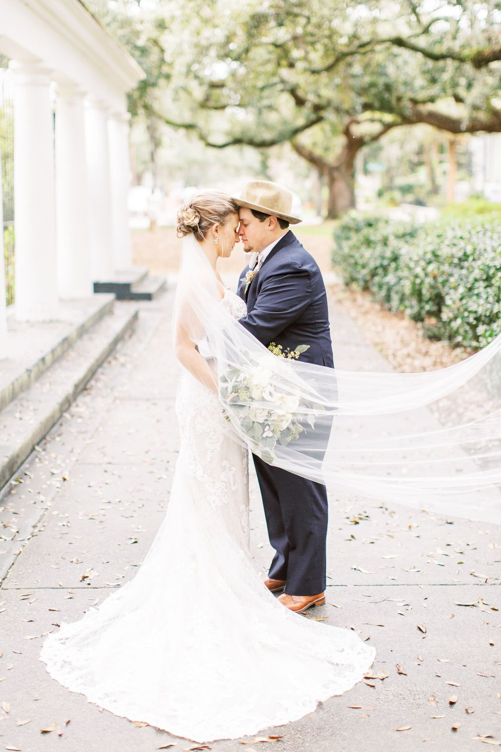kayley and josh taking couples portraits during their savannah, ga wedding