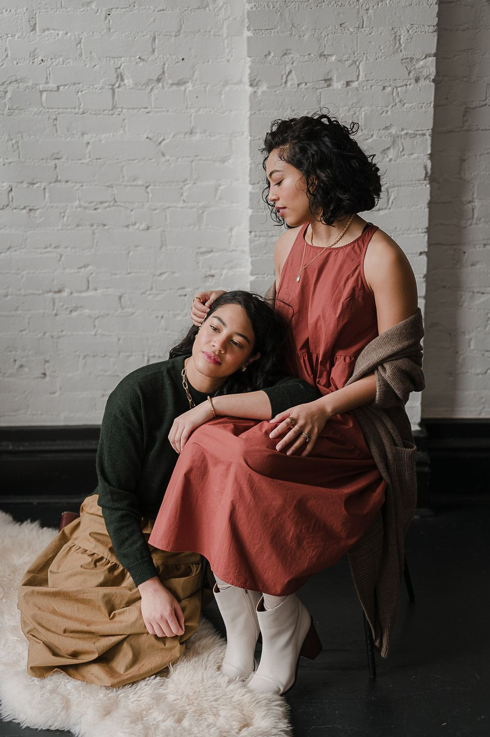 Clothing campaign brand portrait by Tiffany Kelterer of 2 women sitting together in Pioneer Square studio Seattle