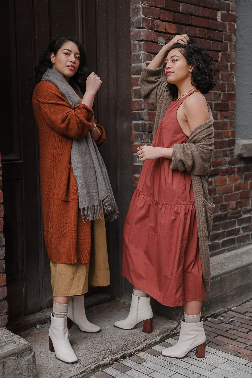 Brand campaign portrait by Tiffany Kelterer of two women standing in brick alley Seattle fashion designers clothing