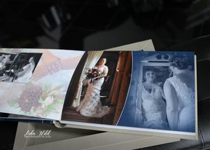 the hitchin barn wedding book page of bride getting ready looking in mirror photographer luba wold north idaho
