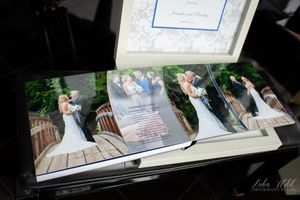 elkins resort wedding book page bride and groom on a bridge photographer luba wold in custom box Idaho