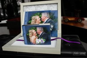 wedding and parents book in custom box bride and groom looking at each other cover photographer luba wold elkins resort