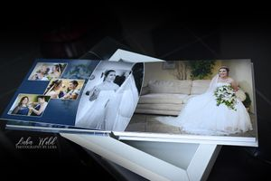spokane wedding book page of bride getting ready photographer luba wold looking in mirror