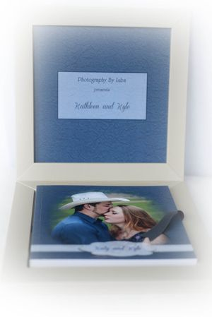 engagement guest book in a box with cover featuring a couple holding each other photographer luba wold moscow idaho