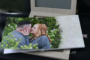 engagement guest book of sandpoint couple kissing in flowers photographer luba wold coeur d alene