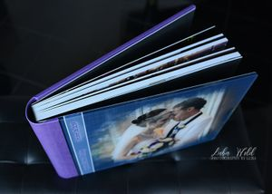 spokane bride & groom wedding book showing strong binding purple leather back and glass cover photographer luba wold