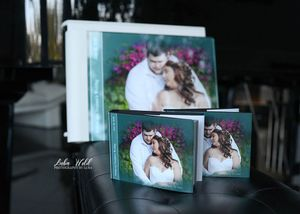 spokane wedding parents and mini books at the castle vineyards photographer luba wold
