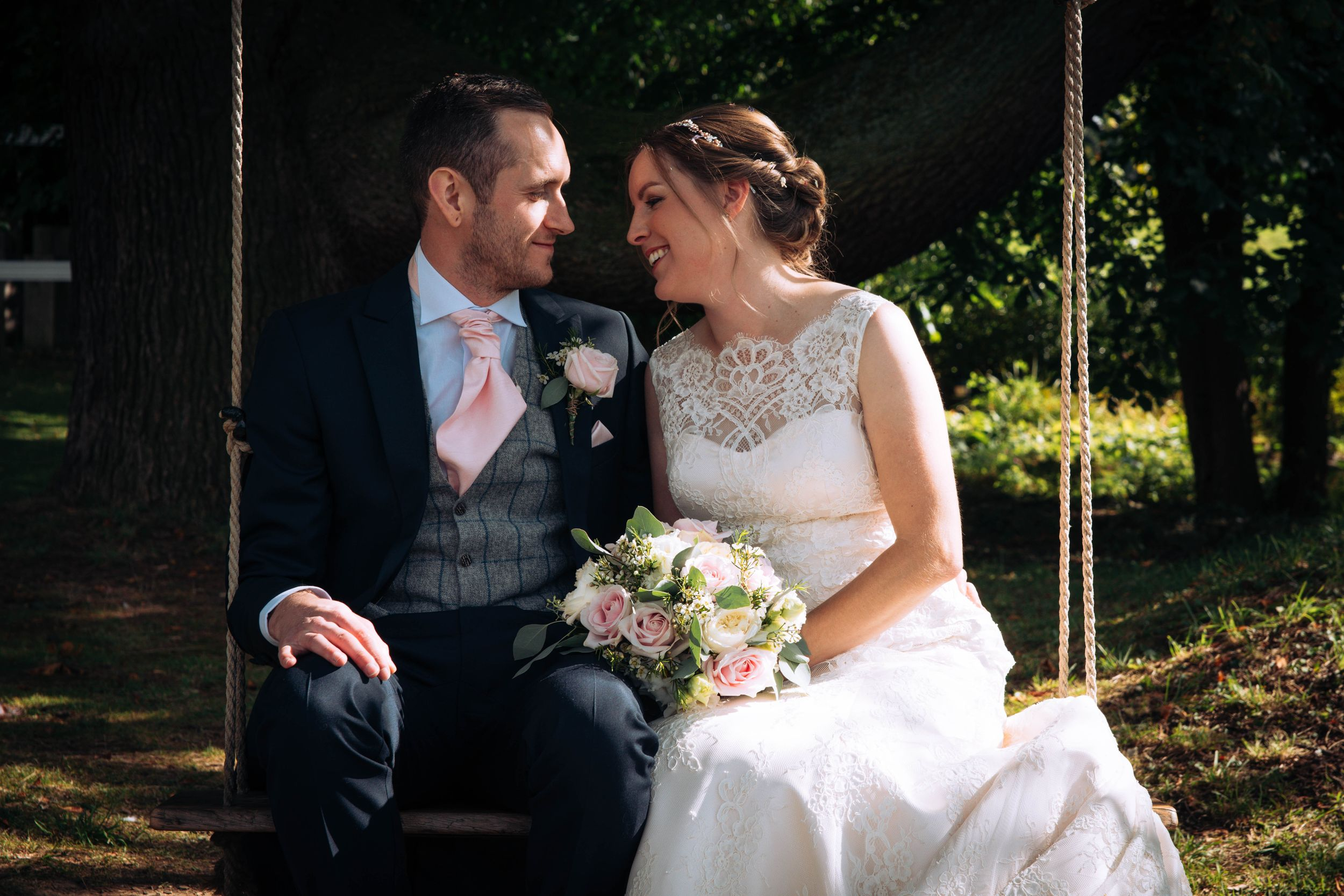 Zara Davis Wedding Photography Near Stroud, Gloucestershire, Cotswolds Glenfall House bride and groom on swing