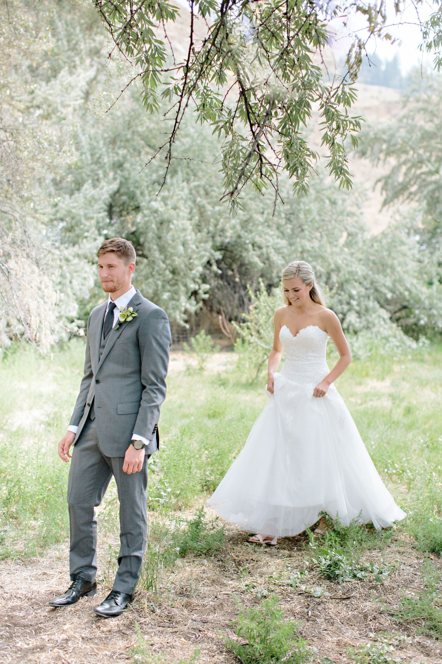 bride and groom first look under olive tree