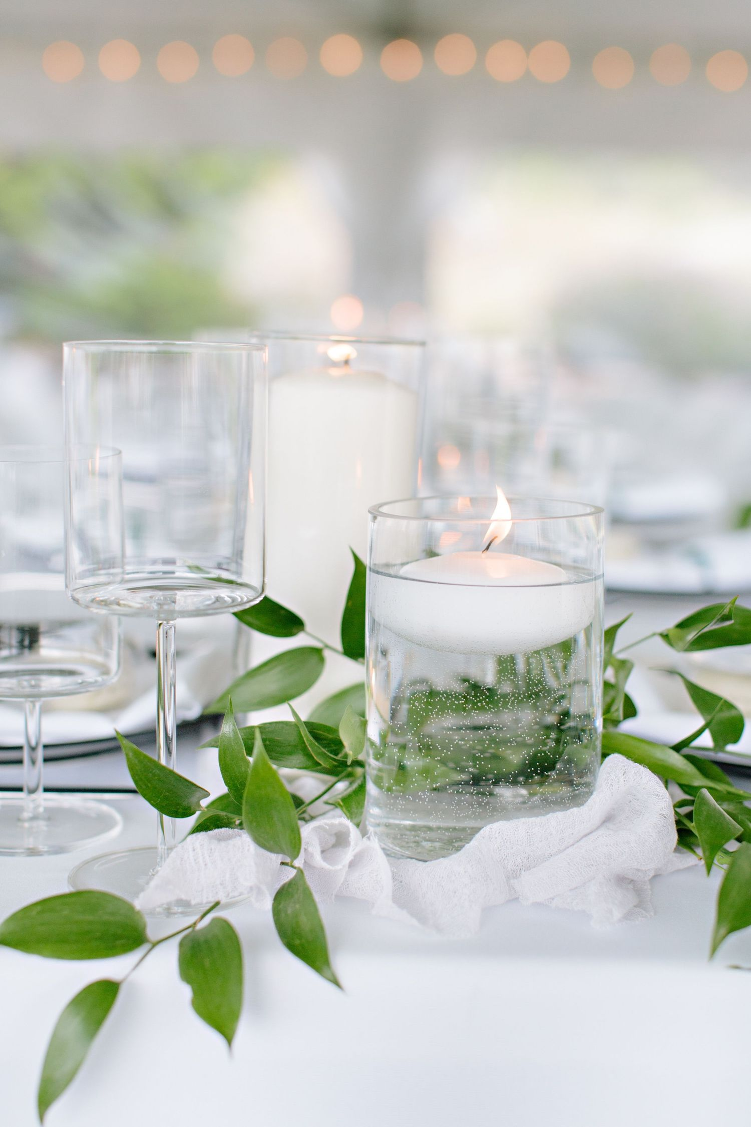 wedding reception greenery details with candles