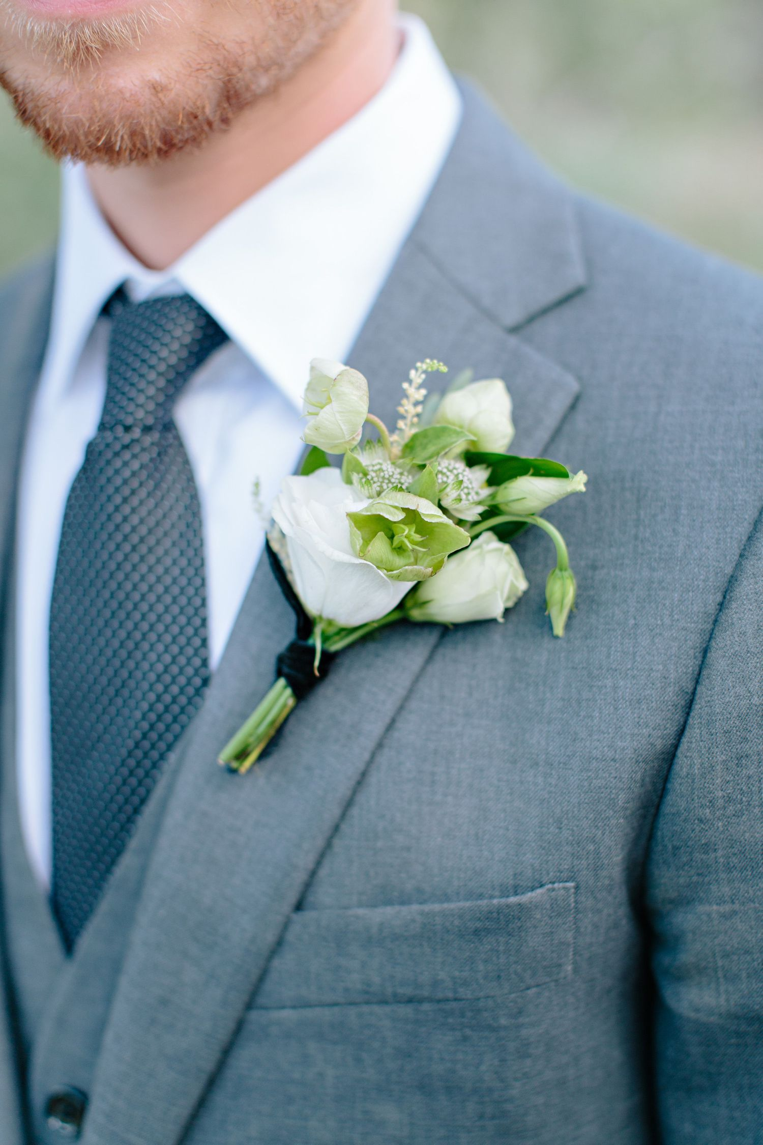 groom boutonniere with white rose