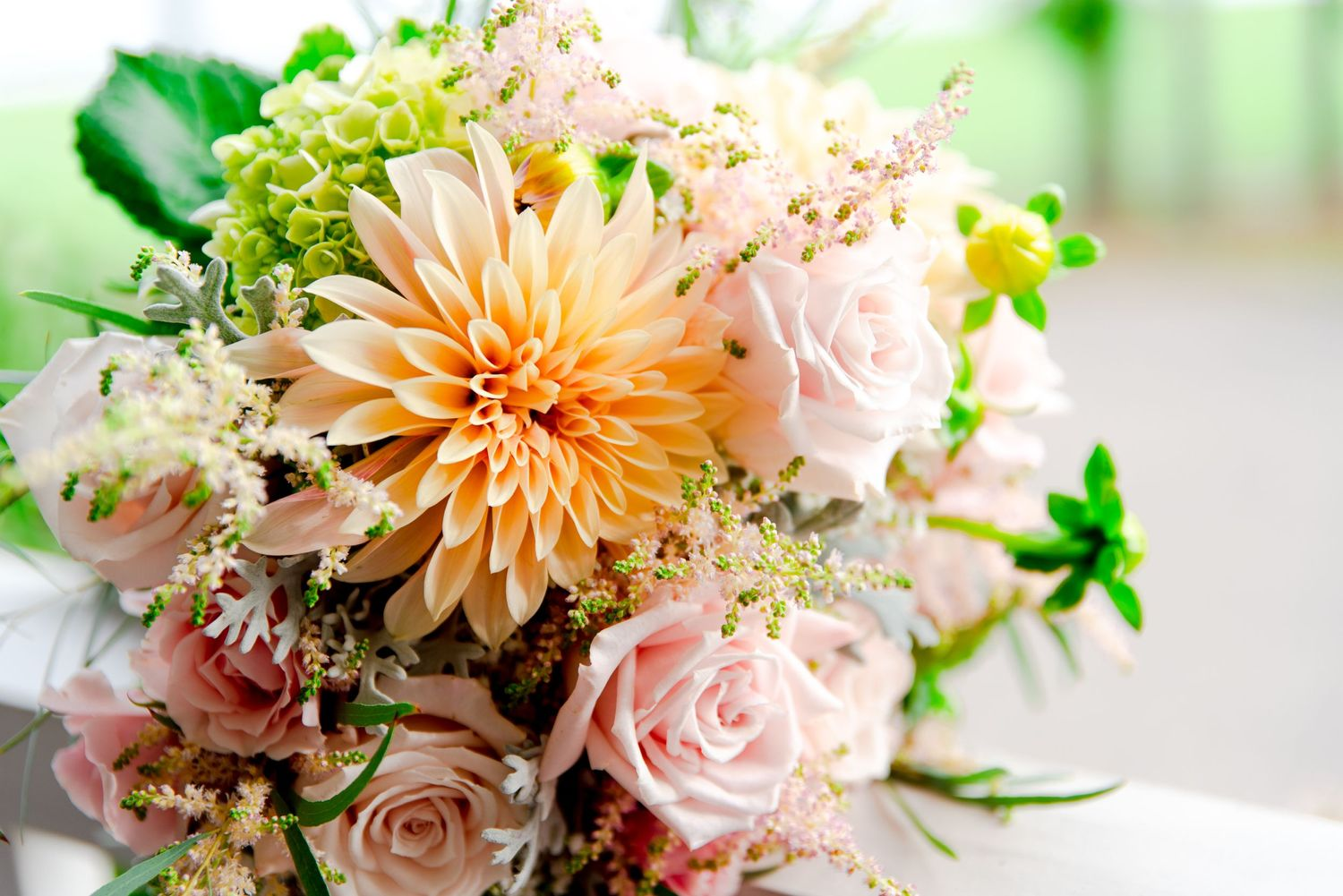 pastel yellow and pink spring wedding bouquet with dahlias and roses