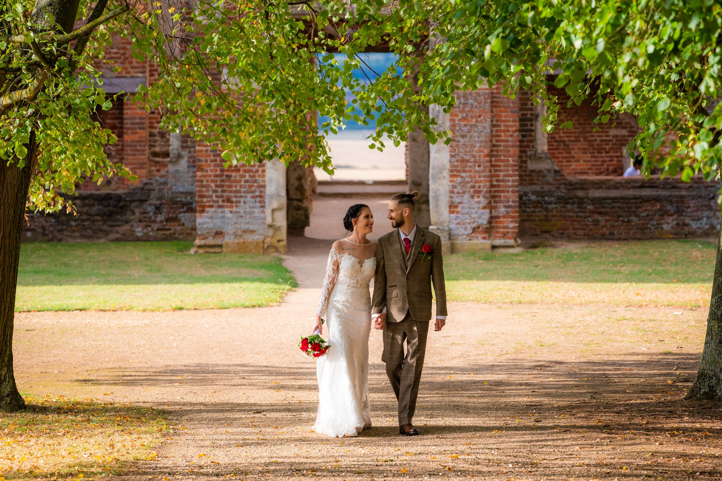 bride and groom walking holding hands, houghton house, Bedfordshire