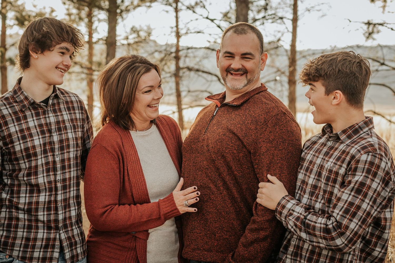 Family smiles at eachother during their Family Photography Session in Fort Collins, Colorado.