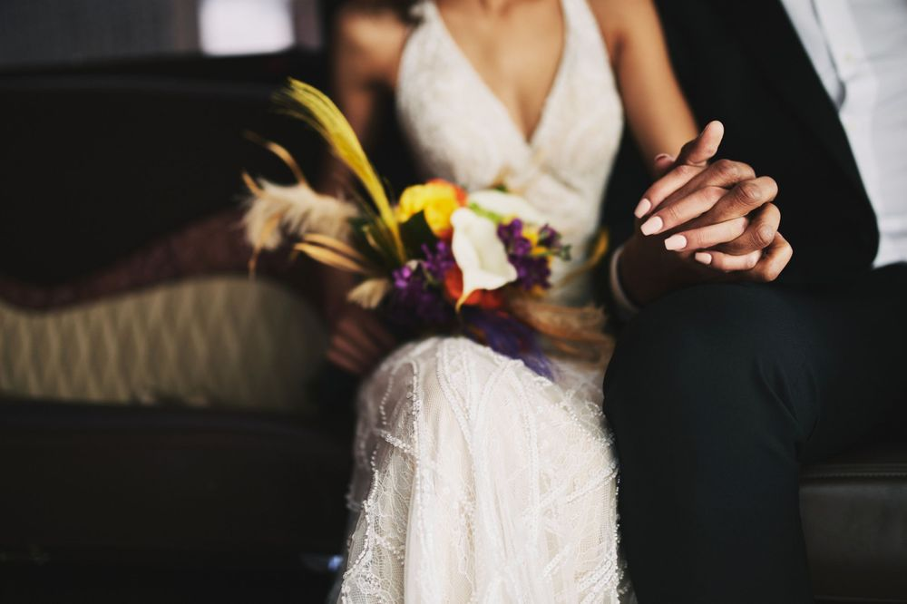 bride's wedding day bouquet and wedding dress