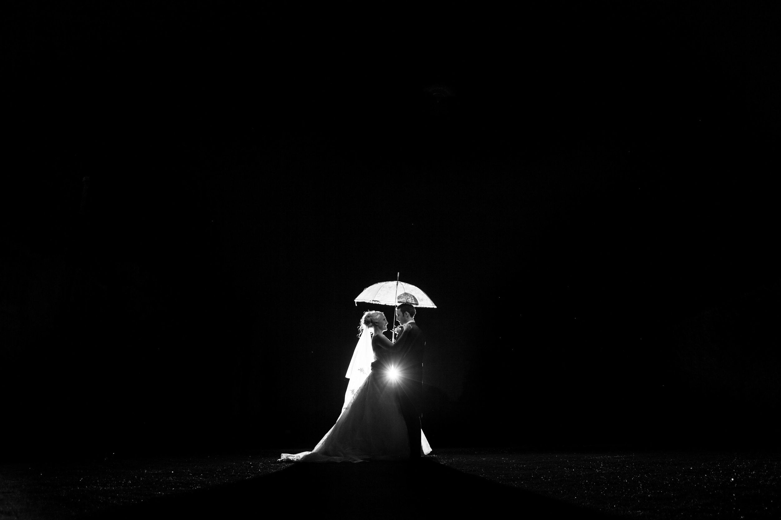Wedding couple silhouette with umbrella