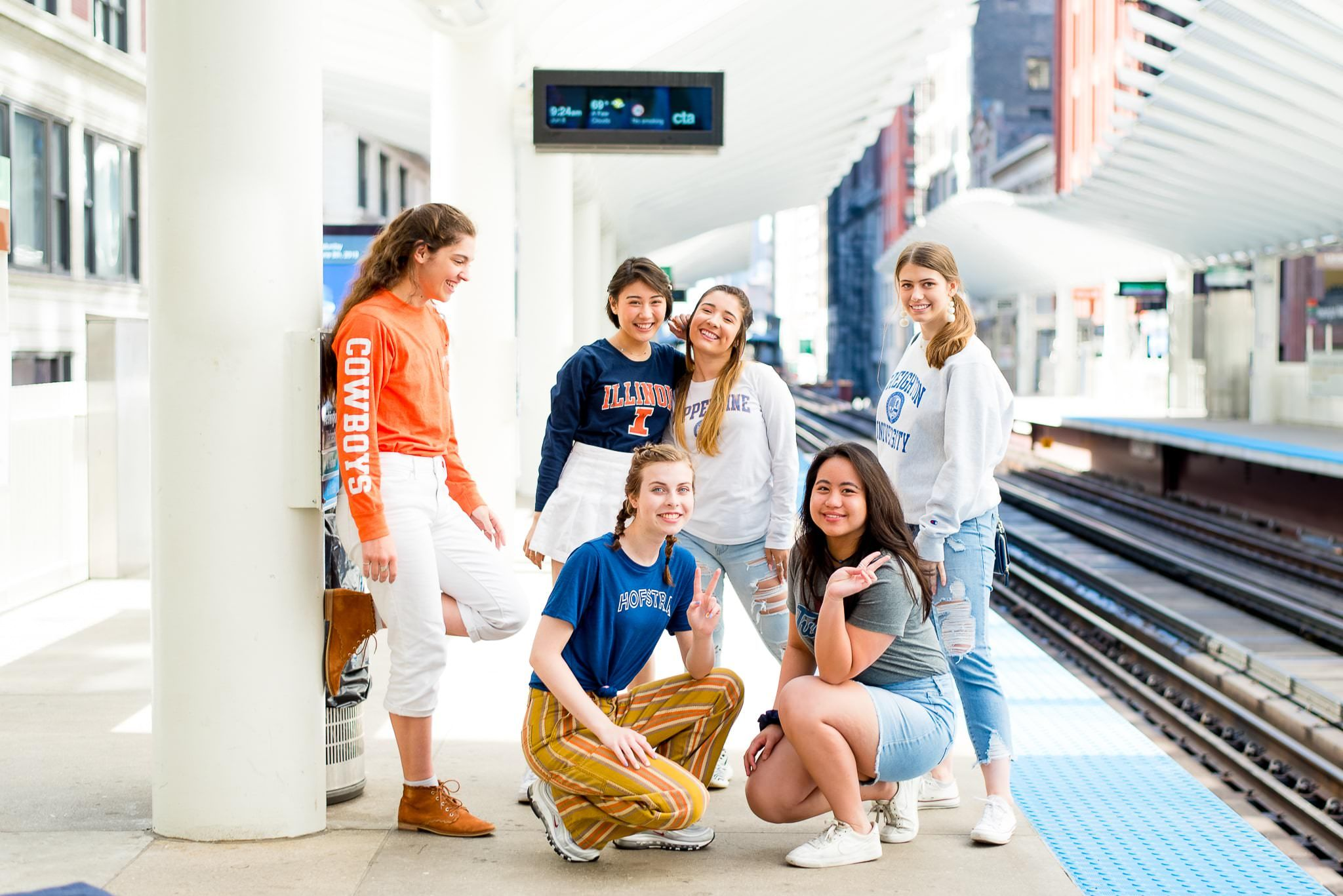 six Chicago seniors at the L station in the loop for chicago senior pictures