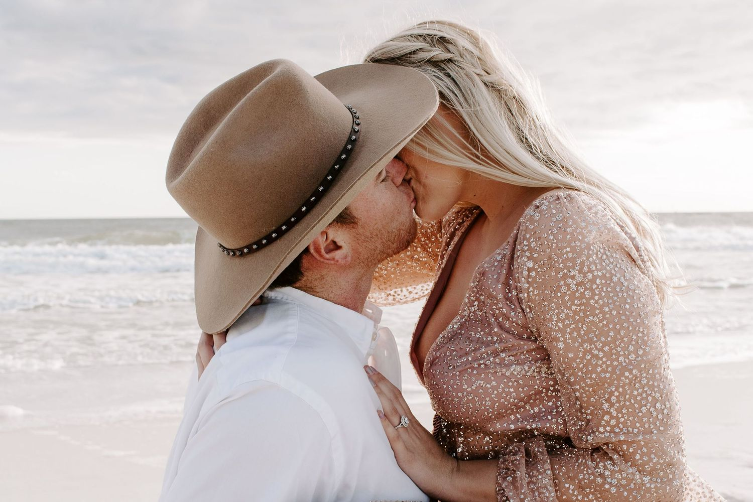 couple kissing on the beach after their 30A intimate wedding