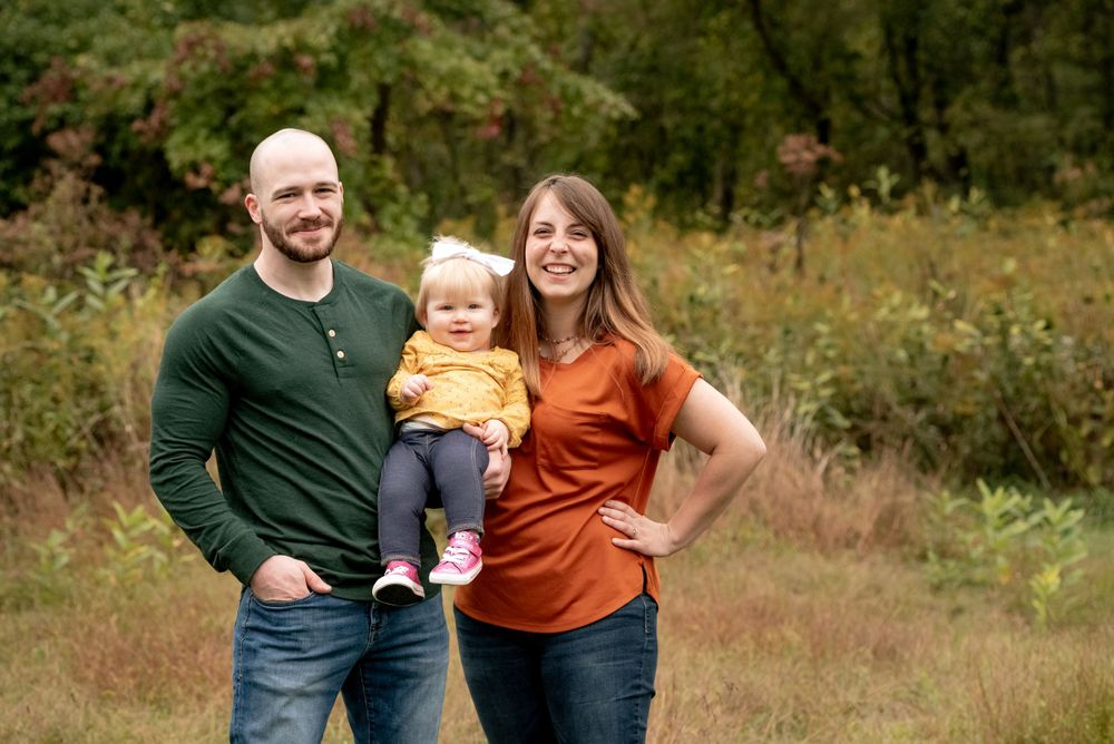 family photo session sewickley heights borough park with mom dad and baby wearing fall colors