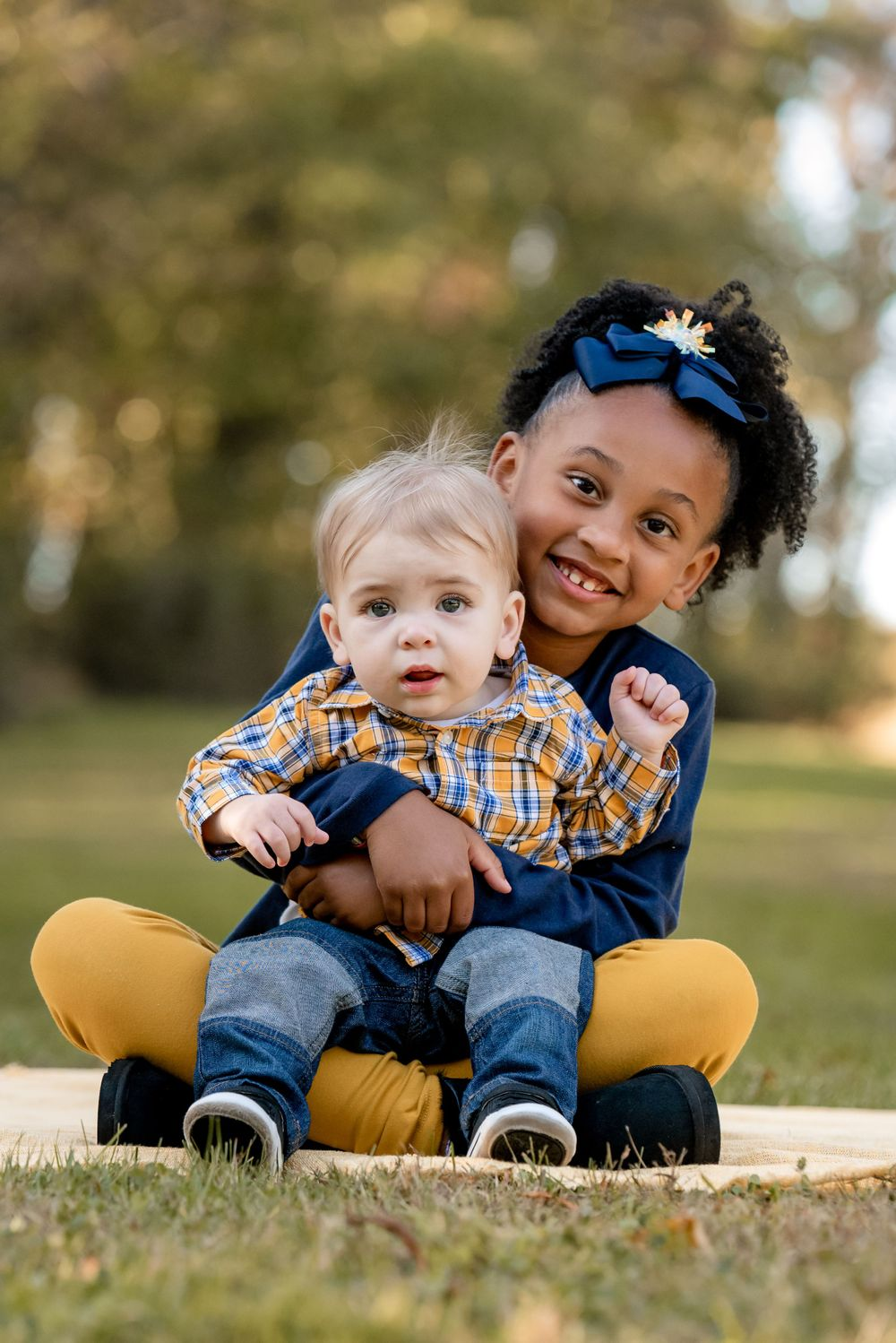 big sister and baby brother during fall family session at sewickley heights borough park