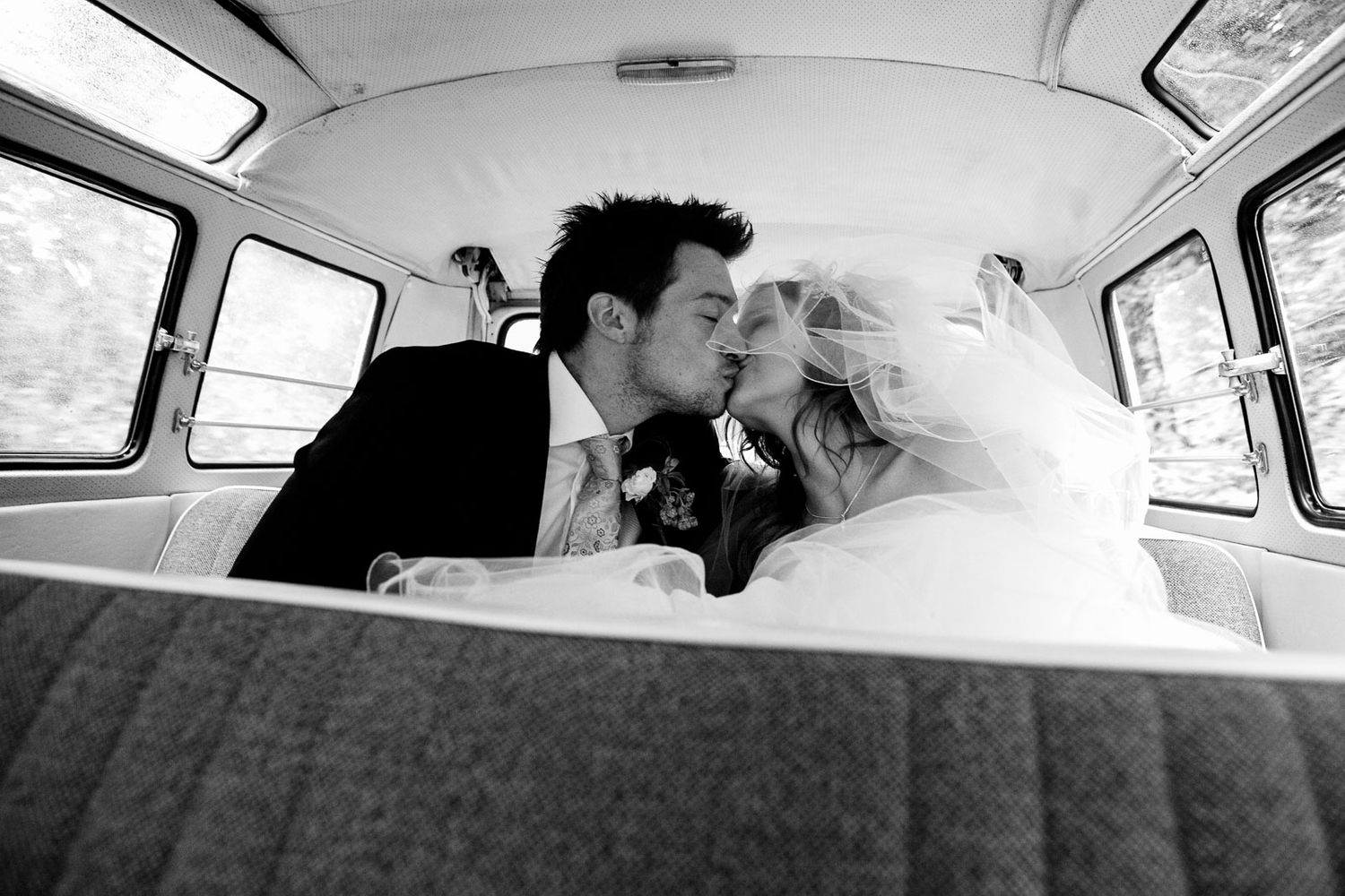 bride and groom wedding photography in classic VW camper van