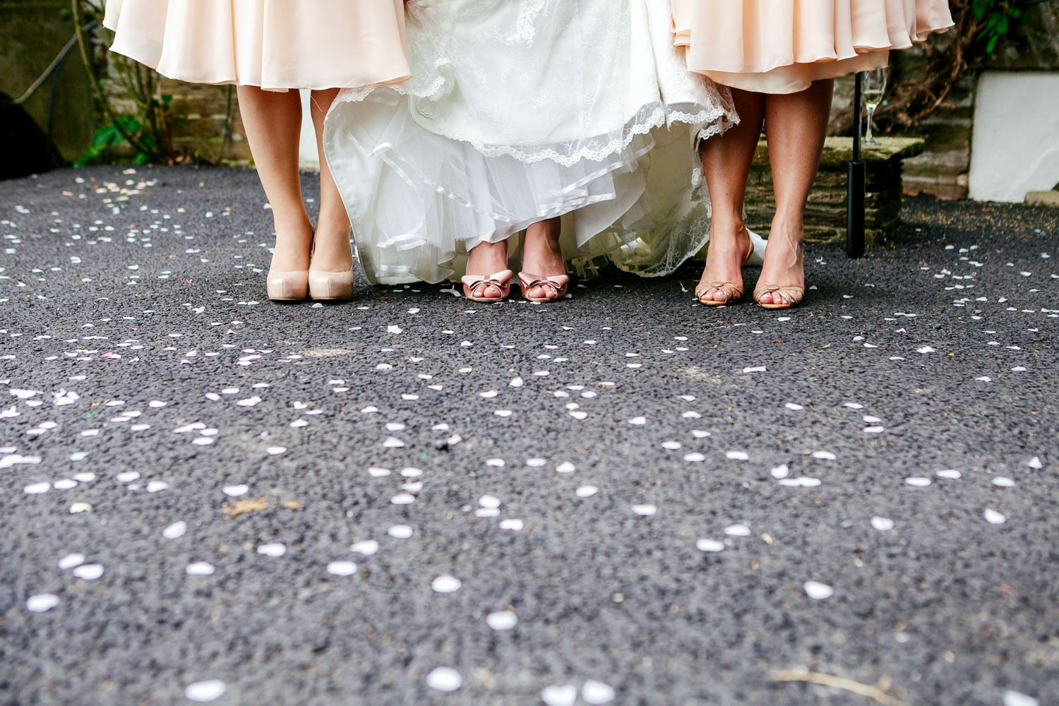 bridal shoes and confetti creative wedding photography by Tuscany wedding photographer