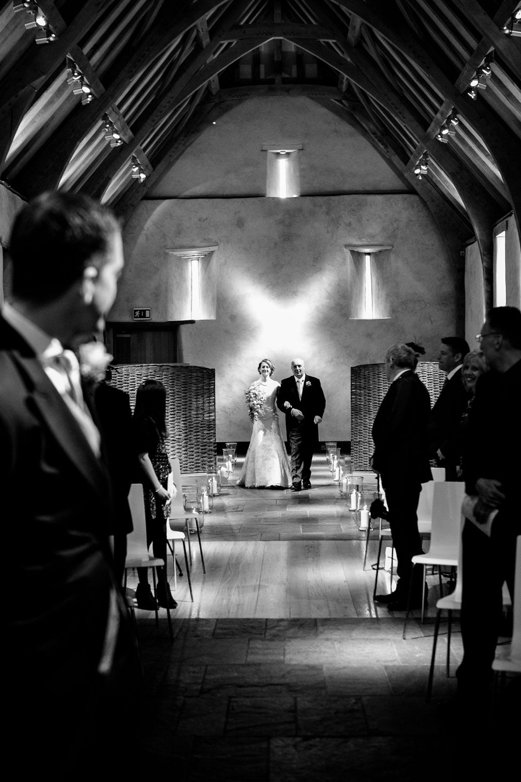 ceremony at Great Barn Devon by destination wedding photographer