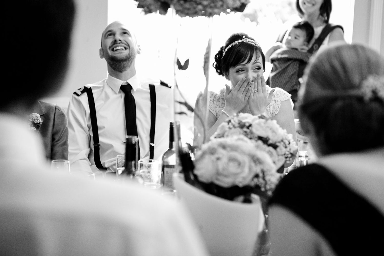 candid moment during speeches at wedding in Langdon Court Plymouth by destination wedding photographer