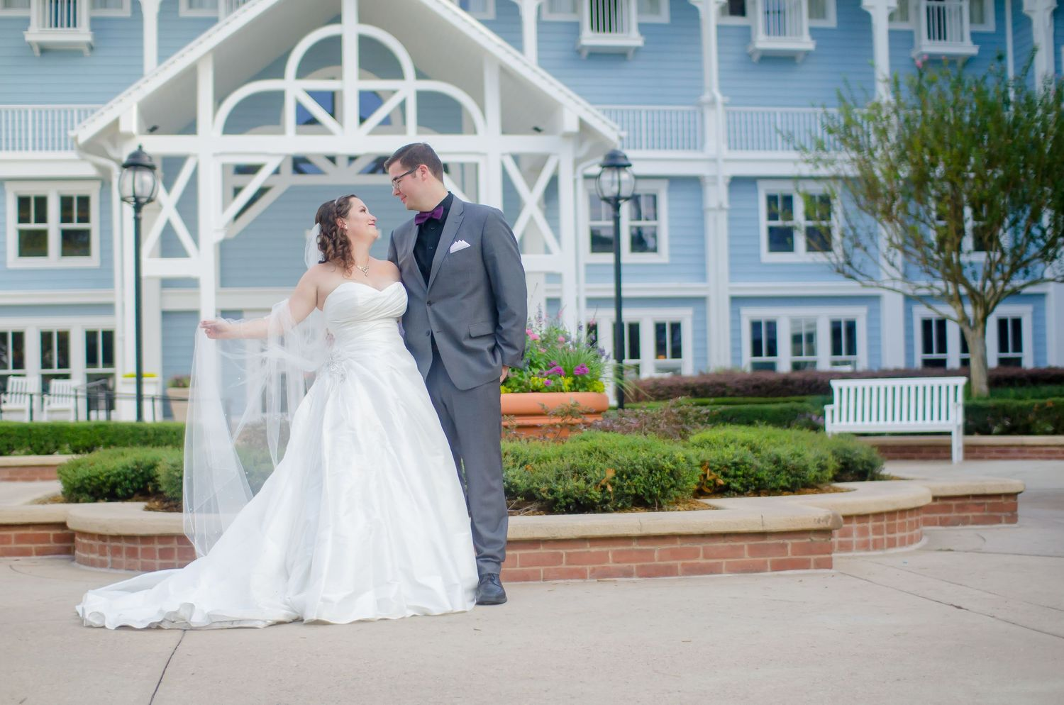 Bride and groom with long veil outside their Walt Disney World Beach Club Resort wedding