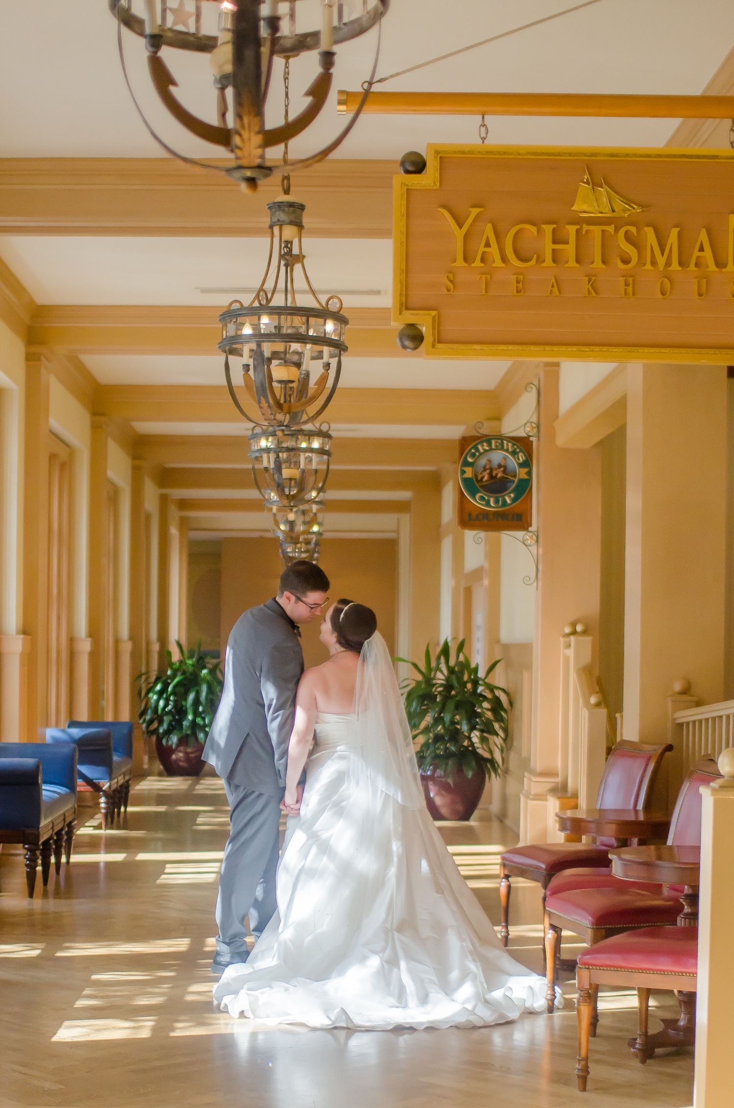 Bride and Groom walking in the hallway on their way to their Walt Disney World Yacht Club resort wedding